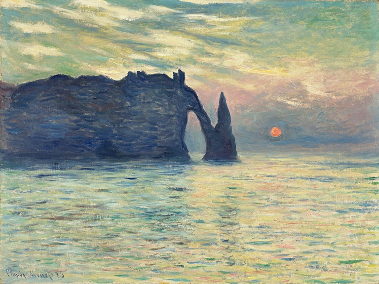 The renowned arched cliffs of Étretat at sunset as portrayed by Claude Monet in his work Étretat, soleil couchant