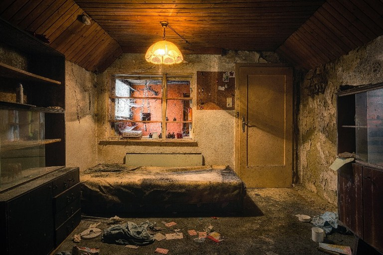 The electricity still functions in this tiny home that was abandoned many years ago