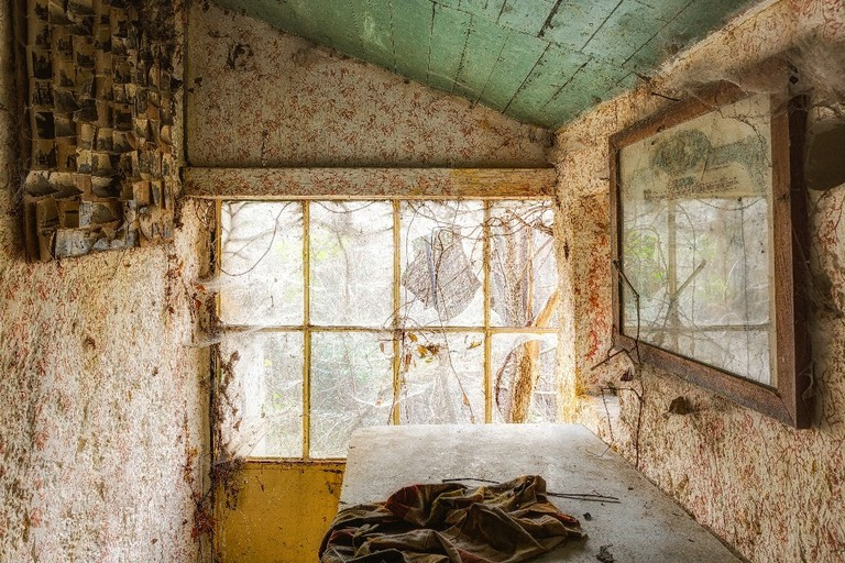 Sunlit room of an abandoned house