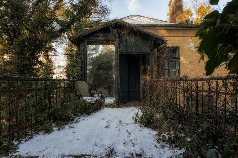 The entrance to an abandoned villa in the snow