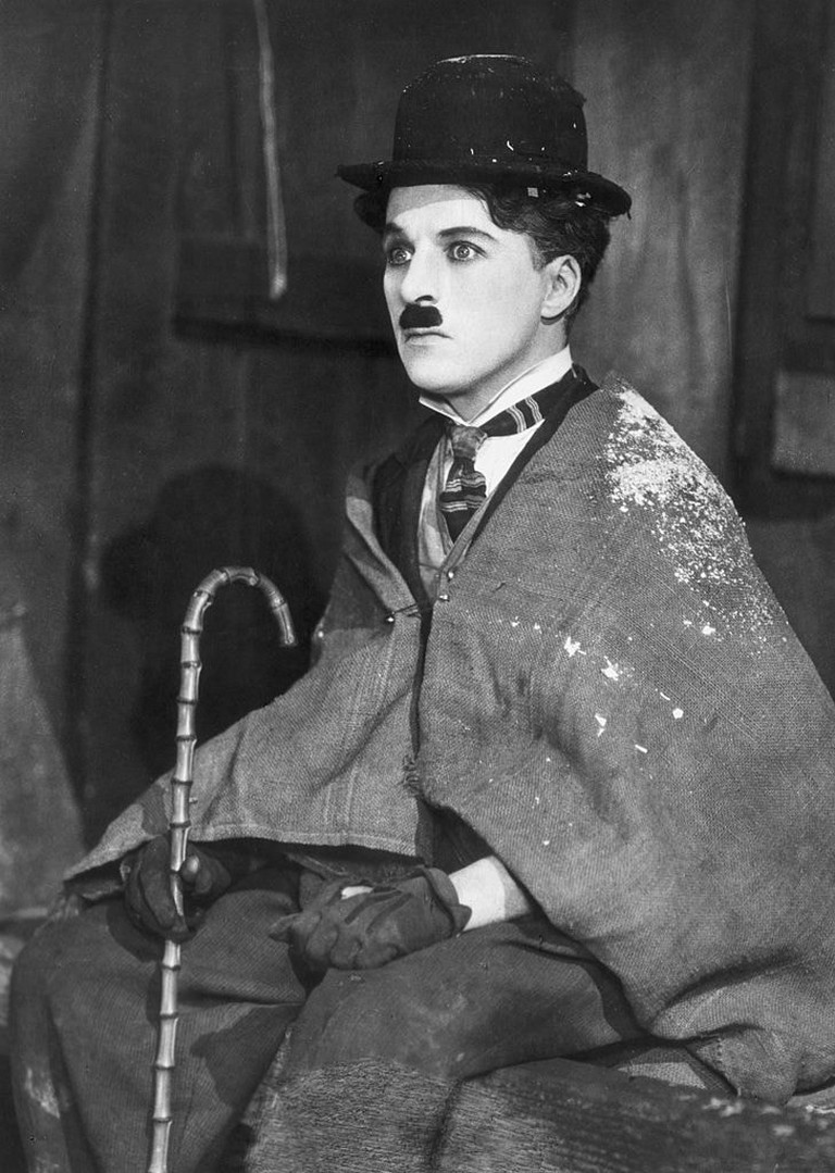 British comic actor and director Charlie Chaplin is seen here as 'The 'Little Tramp' in 'The Gold Rush'