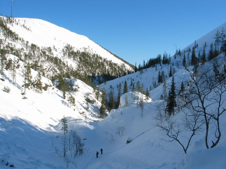 Climbing the mountains of Pyhä-Luosto National Park during winter.
