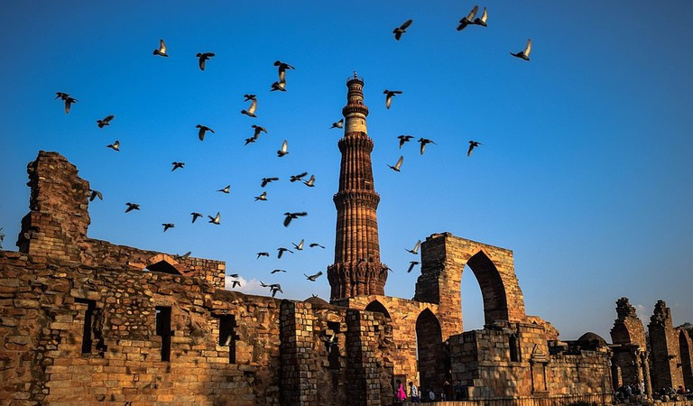 Catch a panoramic view of Qutub Minar, the tallest brick minaret from Thai High
