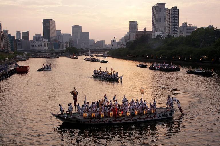A procession of boats in celebration of the annual Tenjin Matsuri.