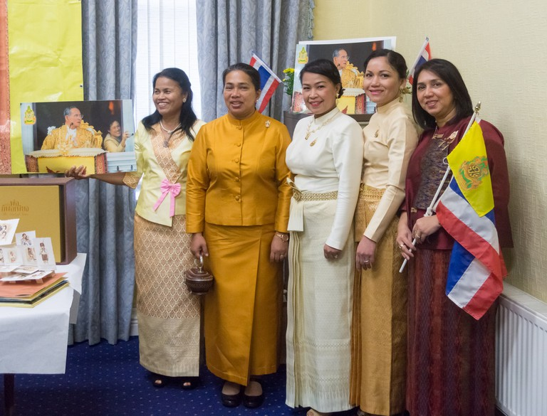 Members of the public wearing chut Thai to celebrate the late King's birthday