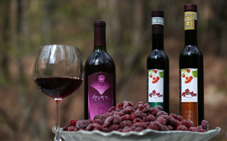 Gimhae's raspberry wine, and a plate of the black raspberries used to make it