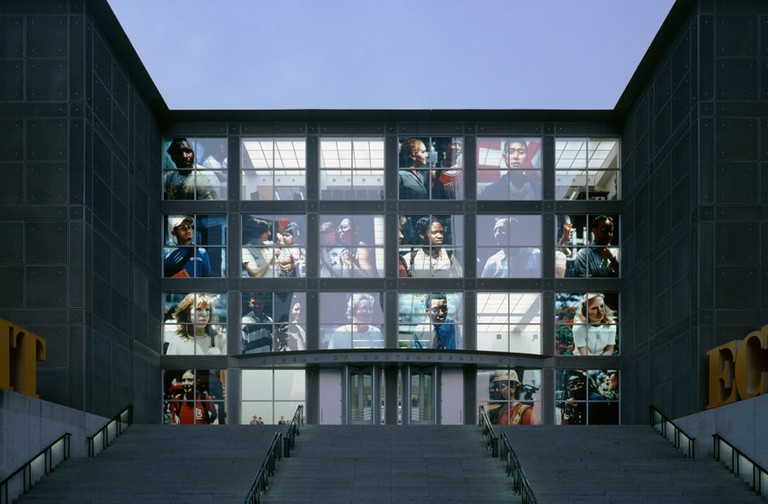 An installation by Beat Streuli entitled, 'Chicago Portraits July 99' at the Museum of Contemporary Art in Chicago
