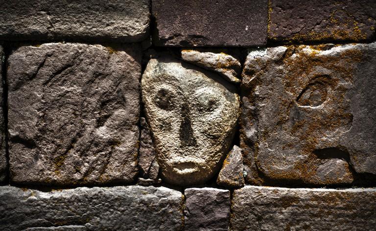 Tiwanaku building blocks with face carving