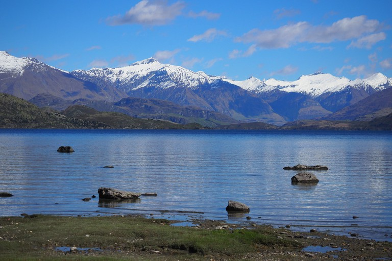 View of the snow-capped mountain peaks from Lake Wanaka