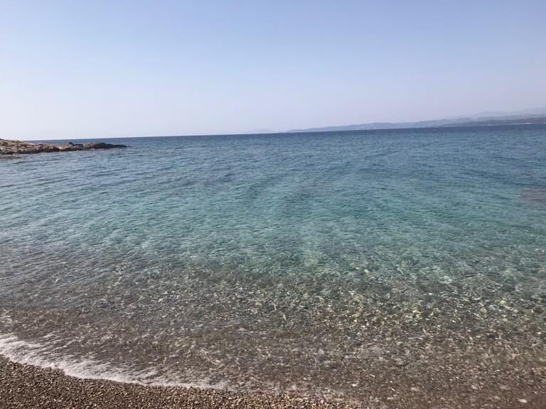Crystal blue waters of Ligoneri beach in Spetses
