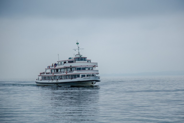 A Lake Constance ferry gliding over the water during a rainy day