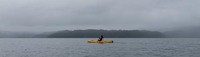 A kayaker in Lake Tarawera, Rotorua, New Zealand