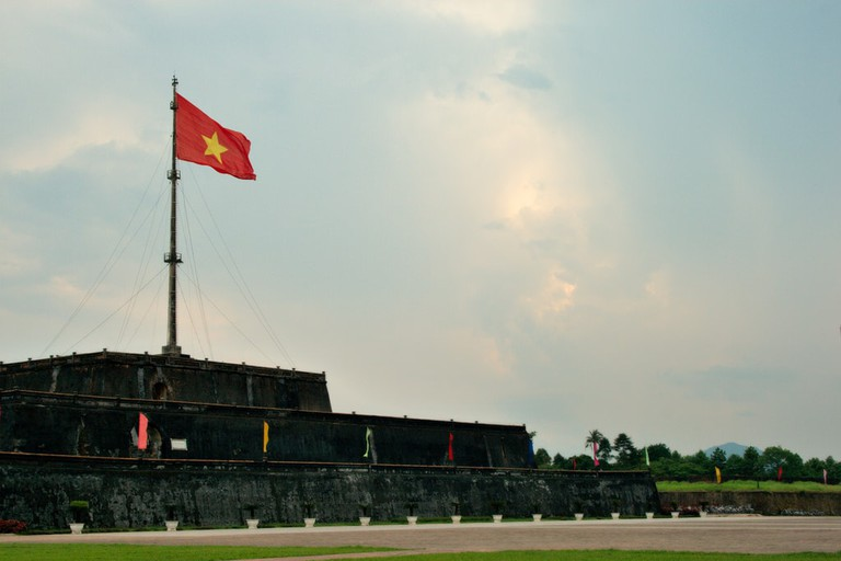 Vietnamese flag flying over the Citadel in Hue