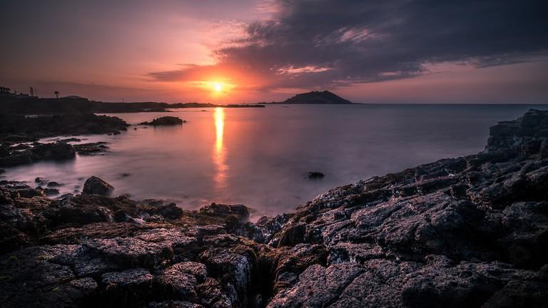 The sun sets over Jeju Island