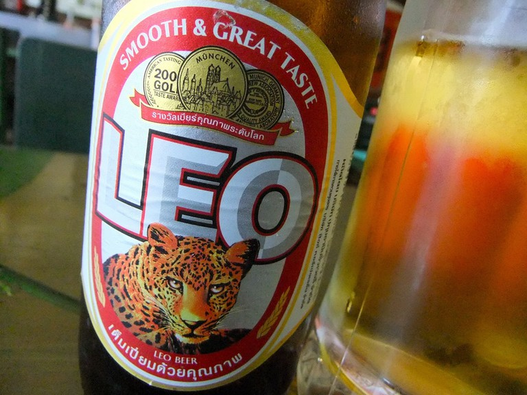 Pick up a bottle of Leo beer at the convenience store.