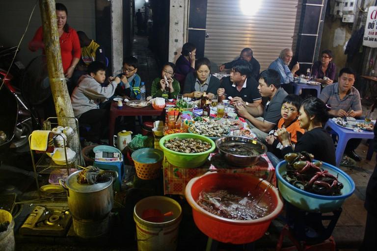 Busy seafood restaurant in Hanoi, Vietnam