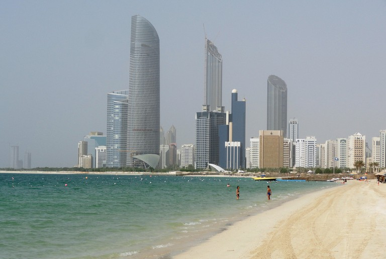 The beautiful Abu Dhabi corniche can be either walked on the white sand, or on the parallel-running walkway