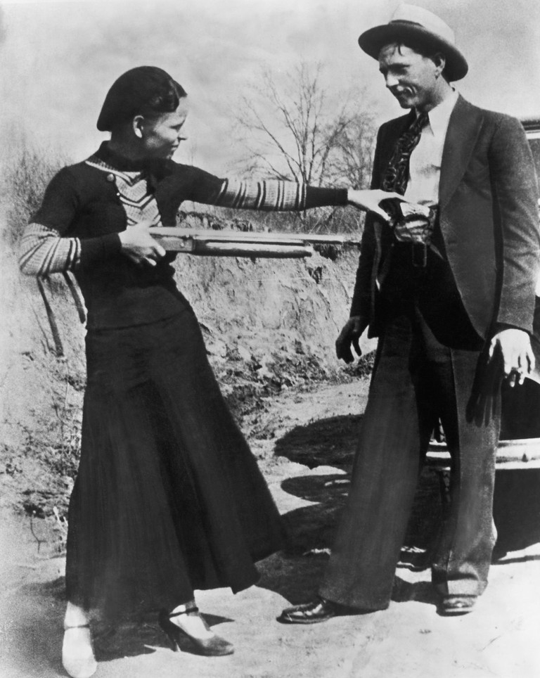 A photograph of Bonnie and Clyde, infamous outlaws from Dallas