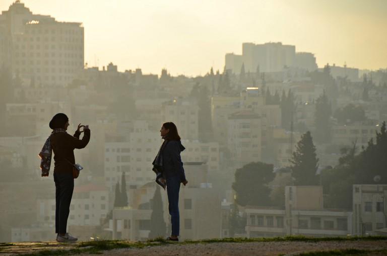 Two women at dusk in Amman