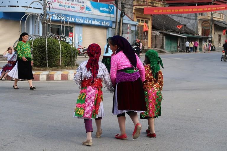 An ethnic minority family at Meo Vac Market