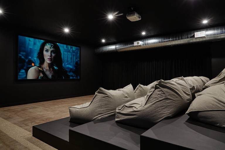 Amenities at co-living complexes often go above and beyond, including this movie theatre at one of Common's apartment complexes