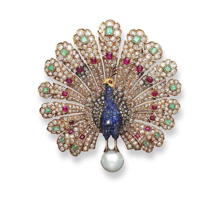 This peacock-shaped brooch is a technical masterpiece with pearls, sapphire, emerald, ruby and diamonds