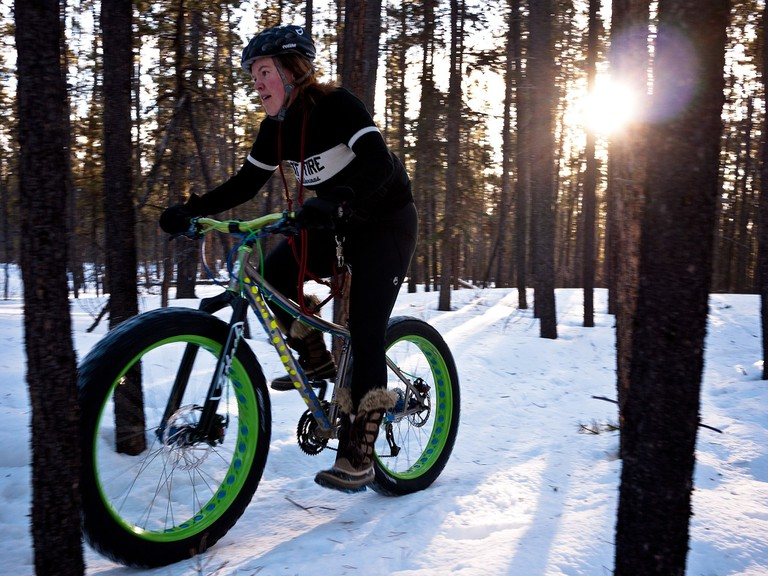 Fat biking through the snow.