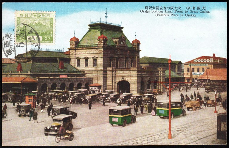 Japan_1934_stamped_postcard_showing_a_street_scene_Osaka_Station