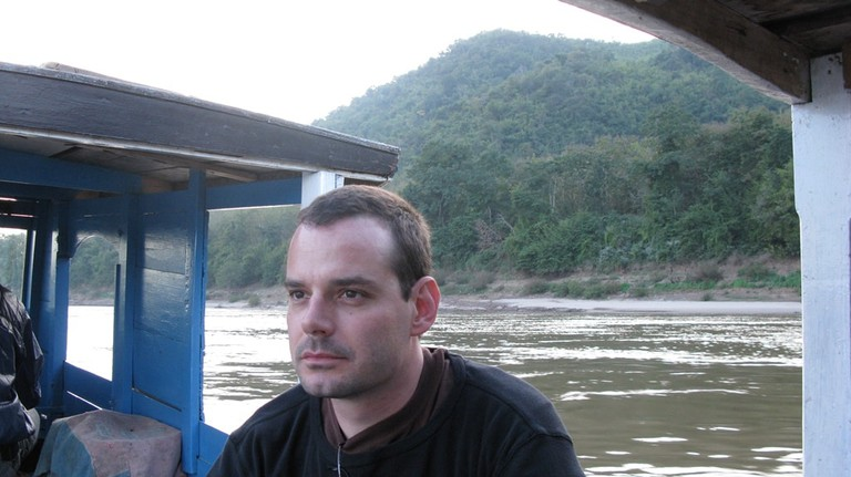 Julian Rademeyer on a river in Laos while researching his book