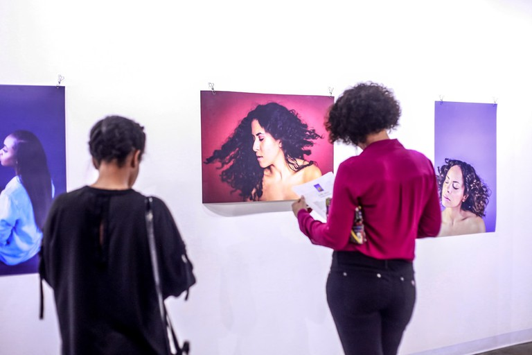 Visitors take in the K.L.R.D. G.R.L.S. exhibit at Umbrella Gallery