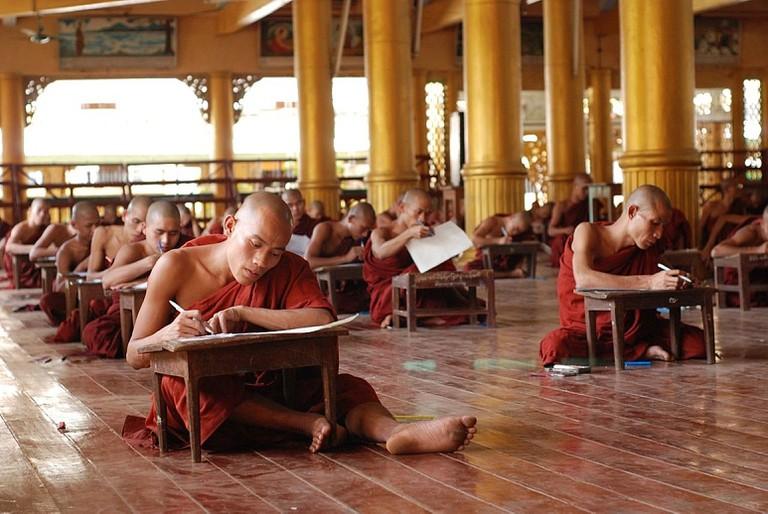 Buddhist students taking an exam