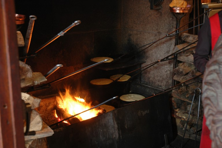 Omelettes cooking over an open flame at La Mère Poulard