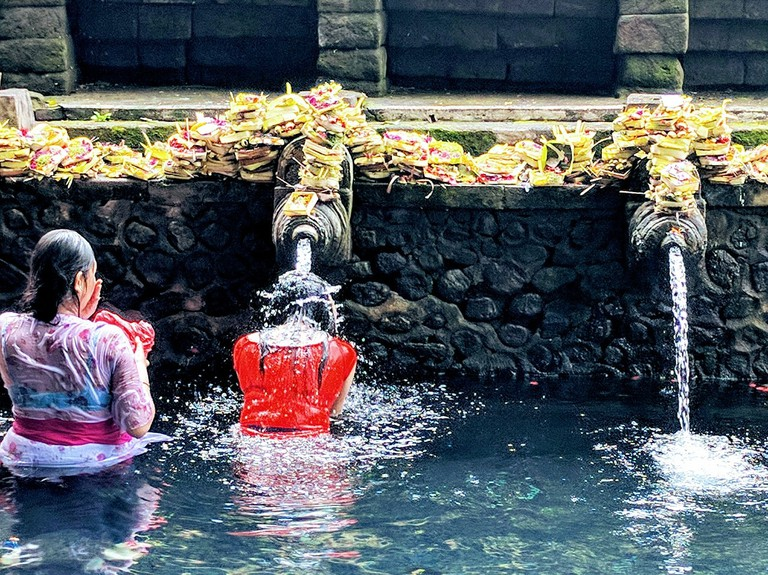 Purifying water at Tirta Empul temple