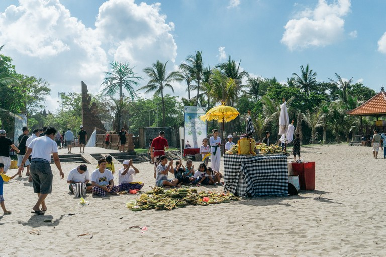 Balinese Hindus gather at temples and shrines to pray.