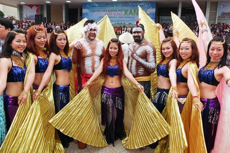 Performers in elaborate costumes