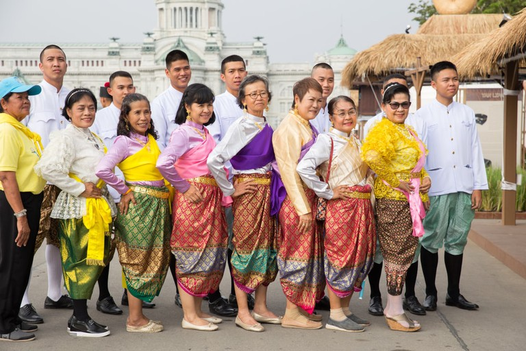 Thai people wearing traditional dress