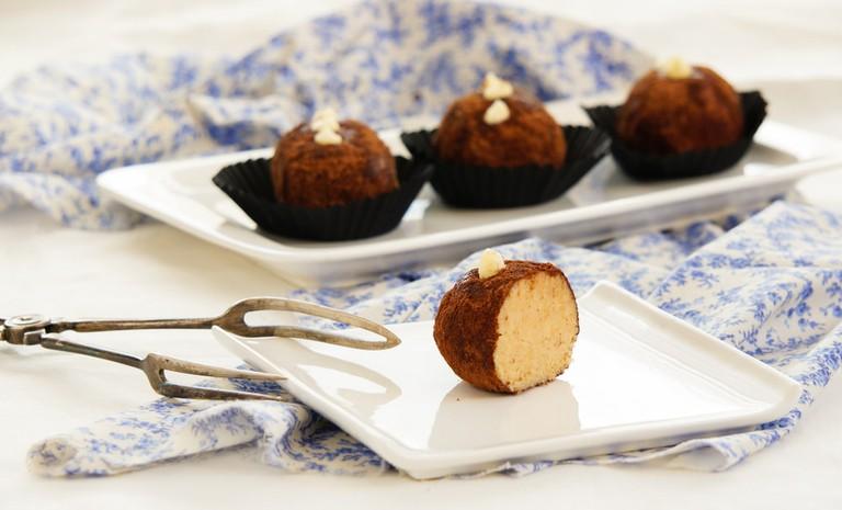 Rum balls of vanilla biscuit with cacao powder