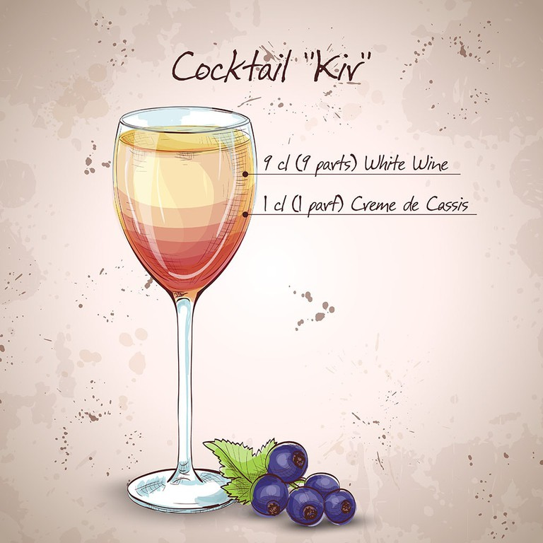 Kir alcohol cocktail, consisting of dry white wine and blackcurrant liquor