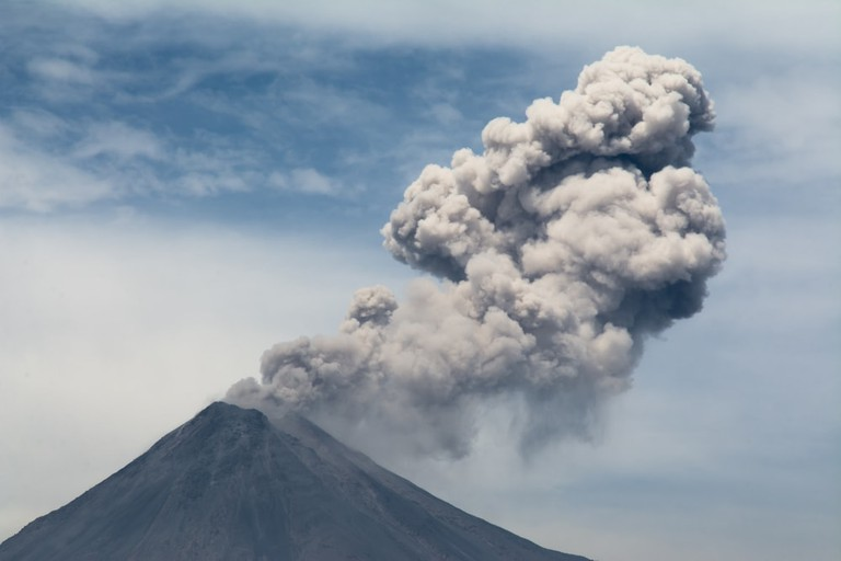 Colima Volcano ejecting a cloud of smoke