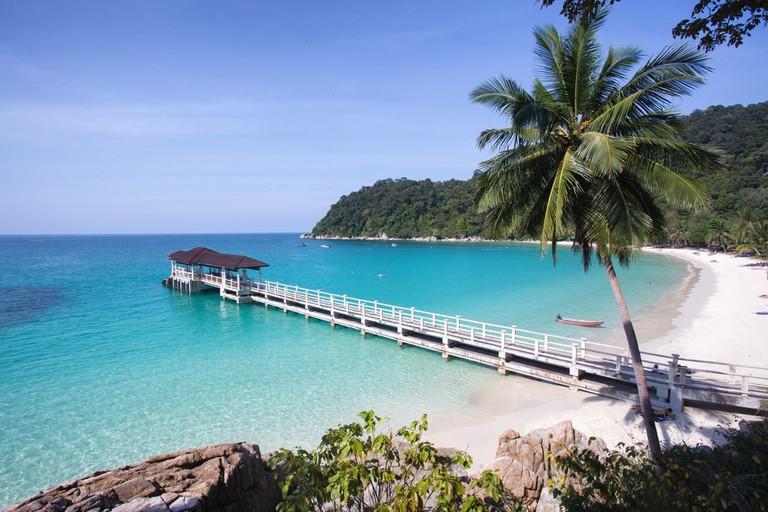 Marvel at the the white sand beaches and crystal clear waters of the Perhentian Islands