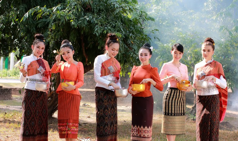 Women wearing Thai national dresses at the Songkran Festival, Thailand