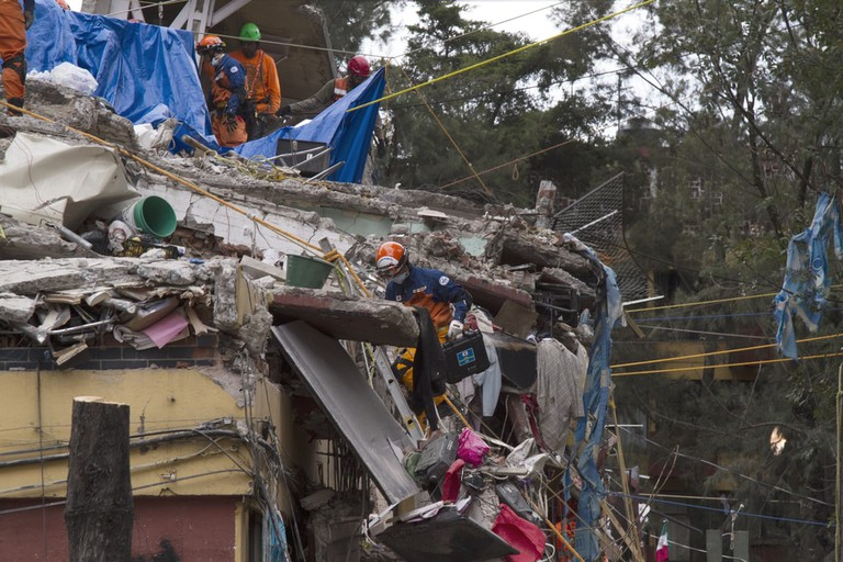 Mexico City, September 2017, rescue workers in the collapsed building located in Taxqueña and Tlalpan