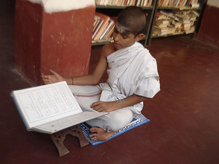 A student learning Veda