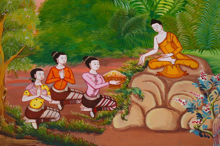 A painting depicting a Buddhist monk imparting knowledge to his disciples