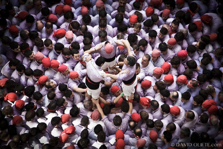 A human tower being set up