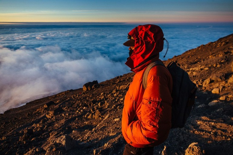 Watching the sunrise from near the peak of Mount Kilimanjaro