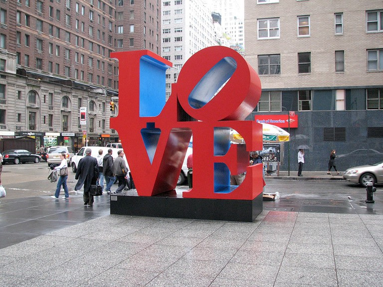 'LOVE' sculpture by Robert Indiana, on the corner of 6th Avenue and 55th Street in Manhattan, NY
