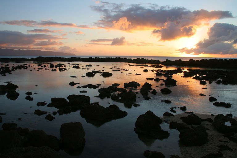 1024px-Sunset_over_Sharks_Cove,_North_Shore_Oahu_Hawaii