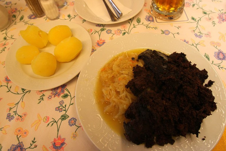 Baked blood with sauerkraut and potatoes