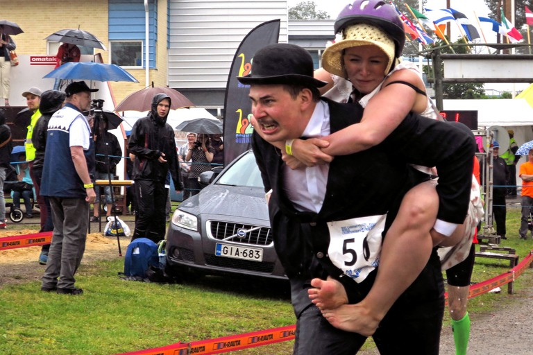 Competitors in costume at the 2015 Wife Carrying World Championship